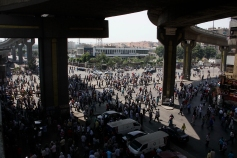 Pro-Morsi supporters run away from rabaa after clashes with police forces